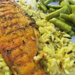 Grilled Tilapia with Smoked Paprika Recipe - Tilapia fillets are brushed with olive oil and paprika and grilled in this quick and easy fish dish, great served with salad on a weeknight.