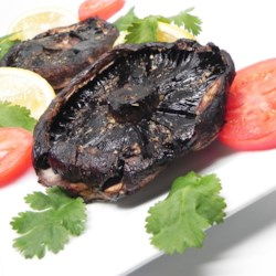 Marinated Portobello Mushrooms Recipe - Restaurants often serve these smoky, tangy mushrooms atop wild field greens; they're good hot or cold.