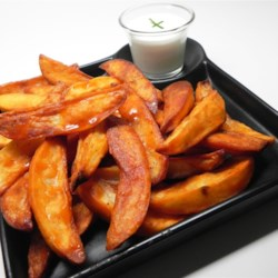 Easy Buffalo Potato Wedges Recipe - This is a simple roasted potato dish that gets a kick from Frank's(R) hot pepper sauce and ranch dressing creating a Buffalo-flavored appetizer.