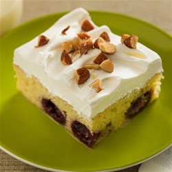 Almond Cherry Tres Leches Cake Recipe - This homemade dessert is as easy as uno, dos, TRES thanks to dessert essentials like canned sweetened condensed milk, canned evaporated milk and canned cherries.