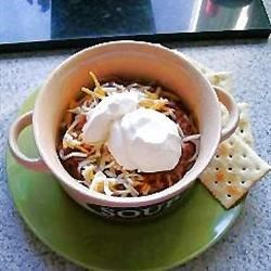 Skillet Chili Recipe - Browned ground beef is combined with a can of hot chili beans, chopped onion and tomato paste in a skillet, then seasoned with chili powder and seasoning salt in this recipe for a thick and hearty chili.