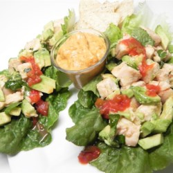 Avocado Chicken Lettuce Wraps Recipe - An avocado chicken salad with lime and cilantro is served on crispy lettuce leaves in this quick and easy recipe for fresh and zesty wraps.