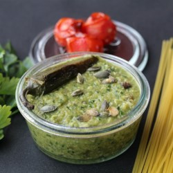 Pasta with Jalapeno Pesto Recipe - Lots of roasting going on here. First the pumpkin seeds and then the jalapeno and green peppers. Then everything is plopped into the food processor  - peppers, seeds, cilantro, garlic, lime juice and olive oil. Next, this incredible pesto is swirled into h