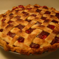 Cranberry Cherry Pie Recipe - This is my favorite recipe to make for the holidays.  It tastes too good to be this easy.  Don't make your own dough?  Just use dough mix or refrigerated crusts - it tastes just as delicious. Originally submitted to ThanksgivingRecipe.com.