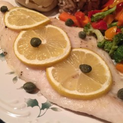 Easy Elegant Baked Fish Recipe - Basa fish, also known as swai fish, is baked with butter, lemons, and capers in this elegant way to prepare fish for dinner.