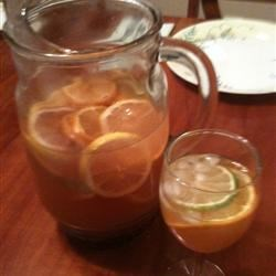 Lisa's Super Sangria Recipe - This recipe calls for gin to chill overnight with lemon, lime, and orange slices before being mixed with white wine, orange juice, cranberry juice concentrate, tonic water, and pomegranate seeds for a fruity sangria that is sure to please your party guests.