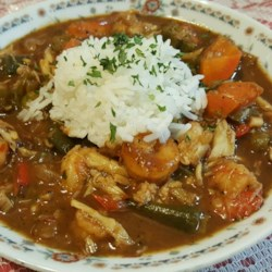 Shrimp and Okra Gumbo Recipe - Okra, shrimp, and a variety of sauteed vegetables are used to create a thick stew, even without the dark roux found in traditional gumbo recipes.