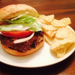 Black Bean Quinoa Veggie Burgers Recipe - These veggie burgers get their texture from black beans and quinoa, and their flavor from hoisin sauce, sesame oil, and garlic.