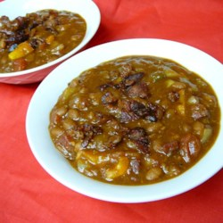 Suburban Cowboy Delight Recipe - Bacon and ground beef, with chili spices and sweet baked beans gives this dish something the old time cowboys would have appreciated.  We eat them with fresh hot sourdough biscuits for a meal that really satisfies.