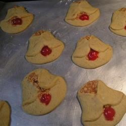 Cherry Bell Cookies Recipe - My mother, who was an avid collector of cookie recipes, always baked this cookie for Christmas. It is one of the many had in her special recipe book, which held only her favorite recipes.