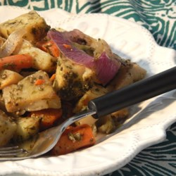 Root Vegetables Baked in Pesto Sauce Recipe - Potatoes, yams, carrots and onion are smothered in a sauce of dill, parsley, basil and olive oil.  A great new way to prepare your favorite vegetables.