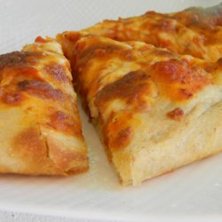Easy Homemade Pizza Dough Recipe - This pizza dough produces a very nice pizza crust--flavorful, tender, with just the right amount of chewiness.