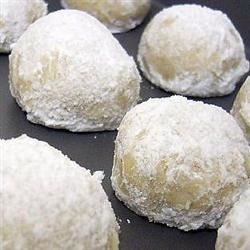 Cream Cheese Snowball Cookies Recipe - Plump, tender little cream cheese cookies, rolled in confectioners' sugar and optional walnuts, look like little snowballs. They have a hint of almond flavor.