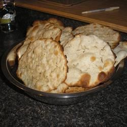 Lavash Cracker Bread Recipe - This is identical to the cracker bread sold at delis in large grocery stores that costs six dollars for three big rounds.  You can make it for pennies!  I fell it love with it as an appetizer with Harvarti cheese melted on it but with the price of the cheese and lavash we didn't have it much.  Make sure you roll the dough VERY thin, almost see-through.