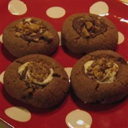 Santa's Chocolate Thumbprint Cookies Recipe - Thumbprint cookies filled with swirled chocolate, toffee bits and maraschino cherry halves.