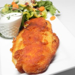 Buffalo Flounder Fillets Recipe - Cayenne pepper sauce adds Buffalo flavor to crispy flounder fillets dredged in gluten-free corn flour and served with blue cheese dressing.