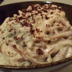 Pasta with Yogurt Sauce Recipe - Mash cloves of garlic into a paste and add to plain yogurt to make a tart and pungent pasta sauce. Toss with warm buttery noodles and garnish with parsley. Toasted pine nuts sprinkled over the top make this dish a special treat.