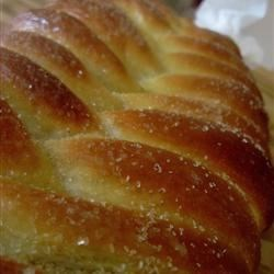 Finnish Nissua Recipe - Nissua is a tender Finnish sweet bread made with cardamom. This bread is formed into braided loaves or wreaths, and topped with a simple frosting.