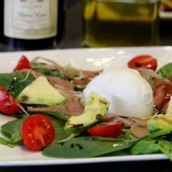 Fresh Avocado Burrata Salad Recipe - An elegant salad of burrata cheese on a bed of fresh arugula, avocado, and prosciutto makes for a quick and easy lunch or gourmet appetizer.