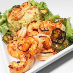 Marinated Broiled Easy Peel Shrimp Recipe - Shrimp are marinated in a spicy marinade with plenty of garlic and then broiled creating a tangy, crisp appetizer.