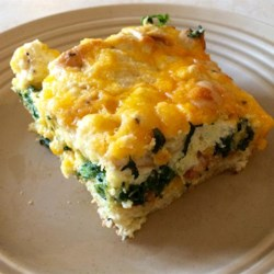 Bacon, Cheddar and Spinach Strata Recipe - Layers of custard-soaked bread cubes with bacon, shredded Cheddar cheese, and spinach in between make an impressive brunch strata from Chef John.