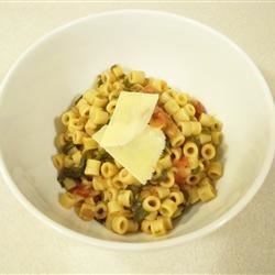Wendy's Quick Pasta and Lentils Recipe - Cook up an easy, hearty meal in just minutes with canned lentil soup stirred into crushed tomatoes, a saute of onion and garlic, chopped spinach and red pepper flakes. Let the mixture warm with tiny cooked pasta, then serve with a sprinkling of Parmesan.