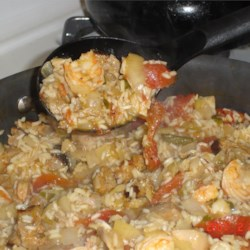 Jenny's Jambalaya Recipe - Chicken, sausage, and shrimp are seasoning with a hot spice mix and served over rice in this recipe for jambalaya.