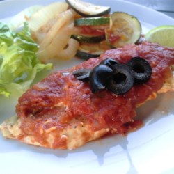 Healthy Mexican Chicken Bake Recipe and Video - Chicken breasts are pan-fried and baked with salsa and cheese for a quick and healthier Mexican-inspired dinner.