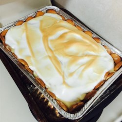 Homemade Banana Pudding Pie Recipe - A homemade stovetop pudding is poured over a vanilla wafer crust and sliced bananas, topped with meringue, and baked. This recipe is old and authentic!