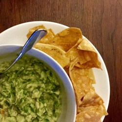 Avocado-Tomatillo Dip with Jalapenos and Cilantro Recipe - Tomatillos give a bit of tang to this avocado dip. Hass avocados, with their pebbly skin, are generally smaller, meatier, and less watery than their smooth skinned counterpart, the Fuerte.