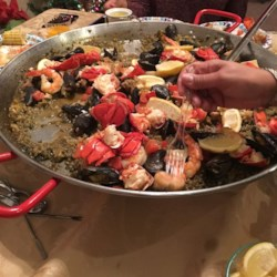 Saffron-Scented Lobster Paella Recipe - Lobster, shrimp, mussels, and snapper are simmered on top of saffron-scented rice in this Spanish classic. Serve this to a group of friends, and they'll keep coming back!