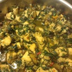 Chicken Eggplant Stir-Fry Recipe - Stir-fry cubed chicken breast with mushrooms, spinach, eggplant, and soy sauce for a quick and easy main dish.