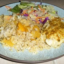 Curried Chicken with Mango Rice Recipe - Skinless chicken breasts are cooked atop a flavorful mango rice in this one dish meal. Ready in 45 minutes or less.