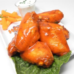 Buffalo-Style Chicken Wings Recipe - Butter, vinegar, hot sauce, and ranch dressing mix are all you need to make a Buffalo chicken wings sauce in this recipe for the all-American classic.