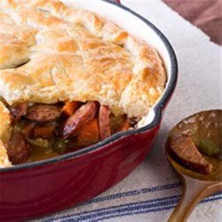 Smoked Sausage Skillet Pot Pie Recipe - Flaky crust and flavorful gravy make this one-pan meal the perfect weeknight dinner.