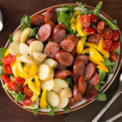 Smoked Sausage Salad Recipe - Dinner was never more beautiful! Let the kids help compose this salad right on the platter before serving.