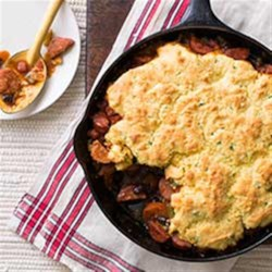 Cowboy Pie Recipe - A Southwest flavor sensation. Smoked Sausage with bell peppers, onions and garlic topped with cornbread is a crowd pleaser.