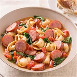 Smoked Sausage and Tortellini Soup Recipe - Nothing is better than a bowl of warm soup filled with cheesy pasta and meaty smoked sausage. Comfort food in 20 minutes!