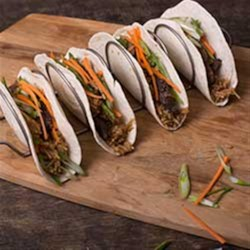 Korean BBQ Beef Tacos Recipe - Try these Korean BBQ tacos tonight; they're packed with flavor and ready in 30 minutes!