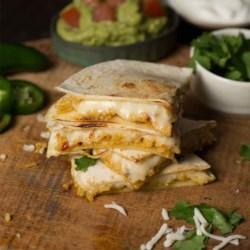 Cheese 'N Rice Quesadillas Recipe - Spice up your next party with our Cheese 'N Rice Quesadillas appetizer recipe that combines green chiles and Mexican rice to create cheesy out-of-this-world quesadillas.