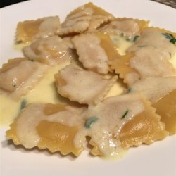 Sweet Sage Cream Sauce (without the Sage!) Recipe - This cream sauce is seasoned with rosemary, thyme, nutmeg, cinnamon, and brown sugar and goes great over butternut squash ravioli.