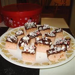 Peppermint Bars Recipe - Christmas bar cookie.  Dough is similar to sugar cookie with peppermint added.  Topped with melted chocolate and crushed candy canes.