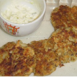 Salmon Patties III Recipe - These salmon patties require a few simple steps for preparation, but the combination of shallots, mashed potato, and a crunchy coating is really delicious.