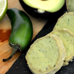 Avocado Compound Butter Recipe - Add a spicy kick to grilled meat or fish with a slice of this luscious avocado compound butter flavored with jalapeno, cumin, and lime.