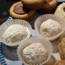 Mexican Wedding Cakes II Recipe - Light, crunchy, round, buttery balls, with chopped nuts in them, coated with confectioner's sugar.   These look nice when placed on a tray in the mini paper cupcake liners.