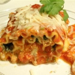 Lasagna Spinach Roll-Ups Recipe - For variety, substitute one pound of cooked Italian sausage for one box of  the spinach. You can use your own favorite home cooked tomato sauce or use sauce from a jar in place of the sauce in this recipe.