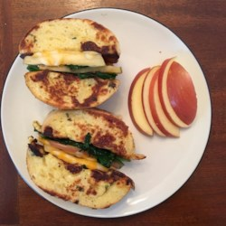 Apple and Cheddar French Toast Sandwich Recipe - French toast sandwiches apple slices, sauteed spinach, and Cheddar cheese for a bistro-style meal that goes well with a glass of wine.