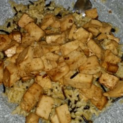 Baked Tofu Recipe - Tofu cubes are marinated in a mixture of soy sauce and ginger before being baked in this simple but effective recipe for a delicious meat-free protein option.