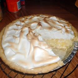 Pineapple Sour Cream Pie Recipe - A homemade pineapple and sour cream custard is covered with a sweetened meringue and baked until golden.