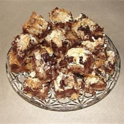 Chocolate Coconut Bars Recipe - Cure your sweet tooth with this easy recipe requiring just four ingredients: graham crackers, chocolate chips, coconut, and sweetened condensed milk.